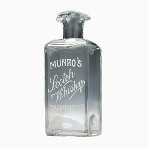 Enameled Munro's Scotch Whisky Serving Bottle, 1910s