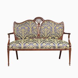Sofá de dos plazas antiguo de tela y caoba