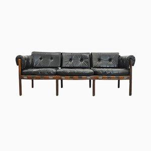 Sofá de tres plazas vintage de cuero negro y palisandro de Arne Norell para Coja, años 60