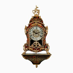 Reloj alemán Mid-Century de madera curvada y latón, años 40