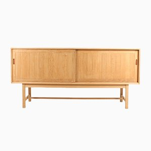 Danish Leather and Solid Oak Sideboard by Kurt Østervig for K.P. Møbler, 1960s