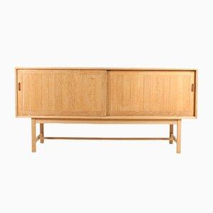Danish Leather and Solid Oak Sideboard by Kurt Østervig for K.P. Møbler, 1960s