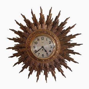 Reloj de pared en forma de sol grande de madera dorada, años 50