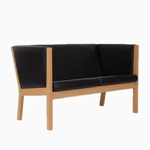 Sofá de dos plazas vintage de cuero negro de Hans J. Wegner para Getama