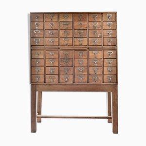 Mueble farmacéutico vintage con 48 cajones, años 40