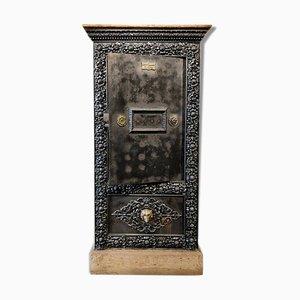 Caja fuerte antigua de madera y metal, década de 1850