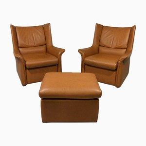 Juego de sillones vintage de cuero con 2 sillas y otomana, años 60