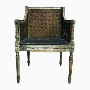 Antiker Armlehnstuhl aus Korbgeflecht