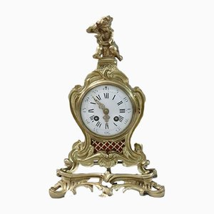 French Brass and Gilt Rococo Style Mantel Clock from Samuel Marti, 1890s