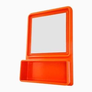 Espejo era espacial de plástico naranja moldeado con estante, años 70