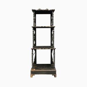 Estante victoriano negro, década de 1850