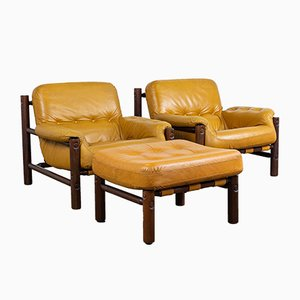 Cognac Patched Leather Lounge Chairs and an Ottoman by Jean Gillon, 1970s