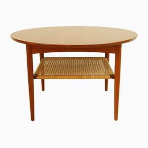 Round Danish Teak Coffee Table with Rattan Magazine Shelf from Mobelintarsia, 1950s