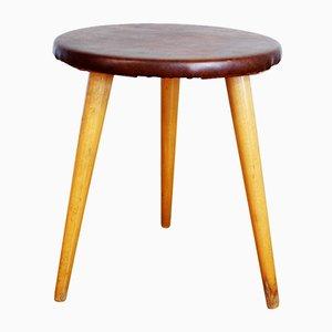 Tavolino tripode in legno e similpelle, anni '60