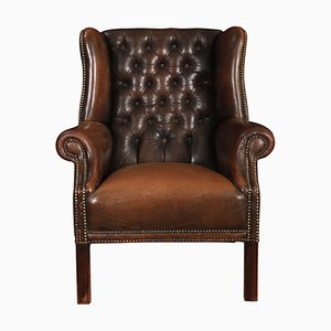 Brown Leather Buttoned Wing Armchair, 1920s