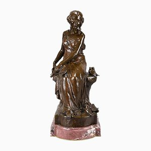 Antique Woman with Bird Sculpture by Maurice Bouval