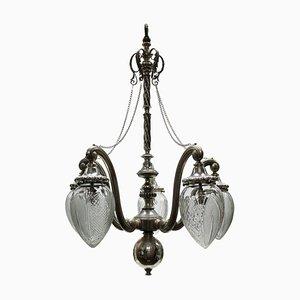 Lámpara de araña antigua de latón y cristal tallado