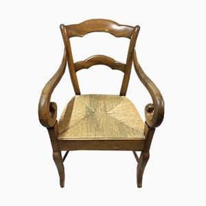 Antiker Armlehnstuhl aus Nussholz & Stroh