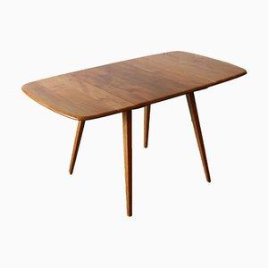 Mesa de comedor abatible modelo 383 de olmo y haya de Lucian Ercolani para Ercol, años 60