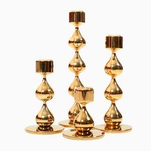 Candeleros daneses Mid-Century dorados de Hugo Asmussen. Juego de 4