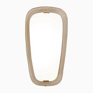Espejo francés vintage oval de metal perforado y latón iluminado de Mathieu Mategot, años 50