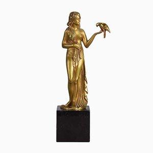Escultura de mujer con pájaro de bronce de Pierre Laurel, años 20