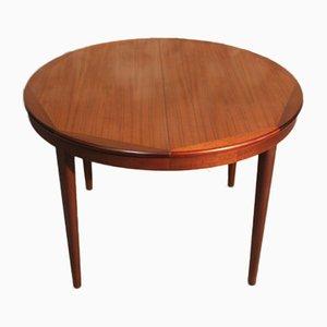 Mesa de comedor extensible francesa redonda de teca, años 60