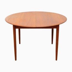 Model 4/6 Round Teak Extendable Dining Table from Arne Hovmand-Olsen, 1960s