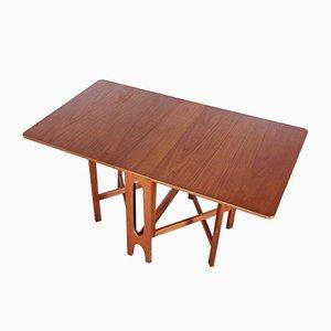 Mesa de comedor modelo 2/6 de teca, años 60