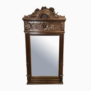 Espejo británico vintage con marco de castaño