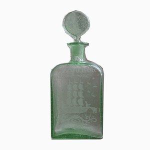 Decantador antiguo en verde de vidrio soplado