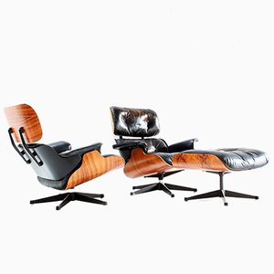 Rosewood Lounge Chairs & Ottoman by Charles & Ray Eames for Vitra, 1960s, Set of 3
