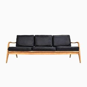 Sofá de tres plazas danés Mid-Century de cuero negro y haya, años 60