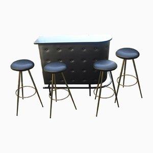 Mesa de bar con cuatro taburetes de Jacques Adnet, años 50