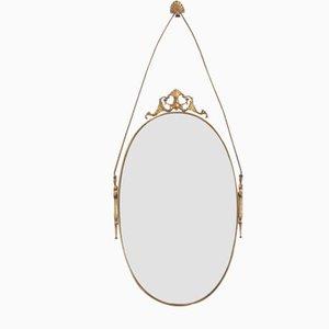 Specchio vintage ovale con cornice in ottone