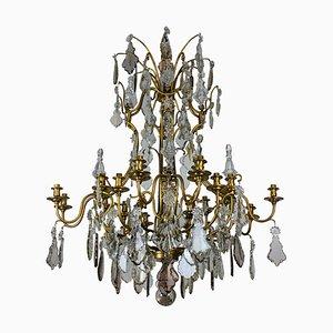 Lámpara de araña francesa vintage grande de latón y vidrio tallado de Baccarat, años 50