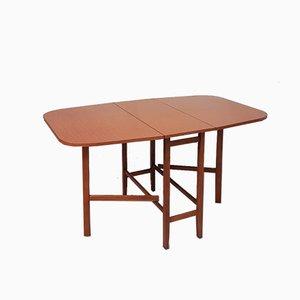 Mesa de comedor extensible de teca, años 70