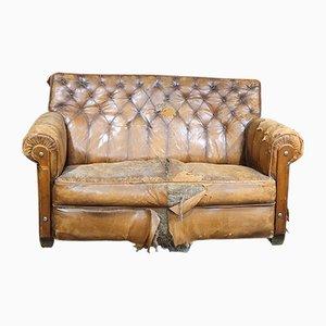 Sofá de dos plazas francés vintage de cuero marrón, años 20