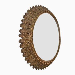 Espejo sol de madera tallada y dorada, años 50