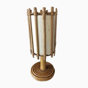 Lámpara de mesa Mid-Century de ratán de Louis Sognot, años 50