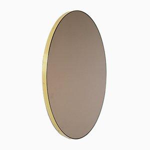 Espejo Orbis grande redondo tintado en bronce con marco de latón de Alguacil & Perkoff