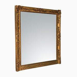 Espejo francés antiguo de madera dorada