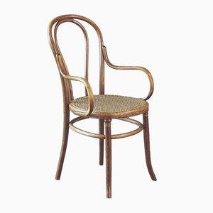 Antiker Armlehnstuhl mit Sitzgeflecht von Fischel