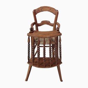 Trona antigua de madera de fresno