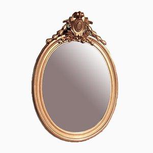 Espejo antiguo oval con marco de madera dorado
