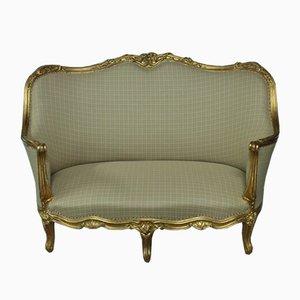 Sofá estilo Louis XV dorado, siglo XIX