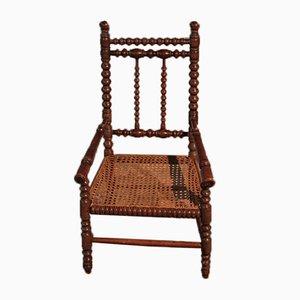 Antiker Kinderstuhl mit Gestell aus Buche & Schilfrohrgeflecht
