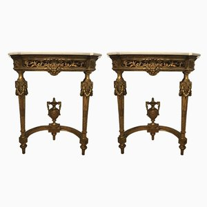 Mesas consola estilo Luis XVI antigua de madera tallada dorada y gesso. Juego de 2