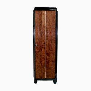 Armario de madera nudosa de caoba y laca negra, años 30