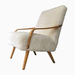 Butaca Art Déco vintage de piel de oveja blanca y madera curvada